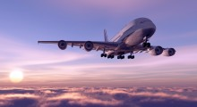 A passenger plane in the sky by Shutterstock